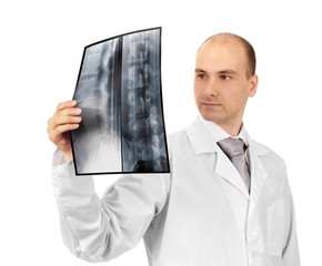 Young attractive doctor studying x-ray image