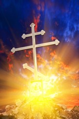 christian cross on a dramatic sunset background