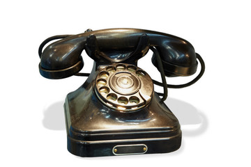 Old-fashioned desk telephone with rotary dial