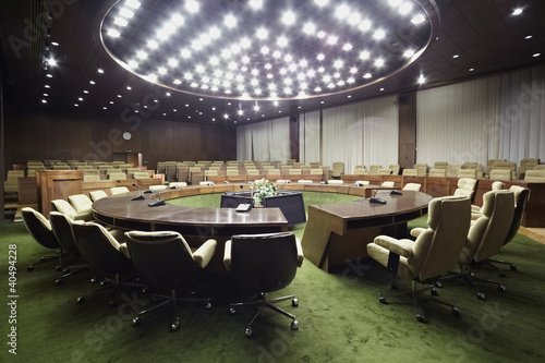Round table with armchairs in the auditorium.