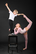 Girl and little boy gymnast took graceful pose at bark chair