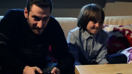 Father and son playing with videogames