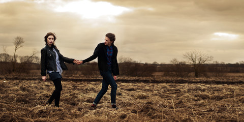 beautiful couple posing in a spring field