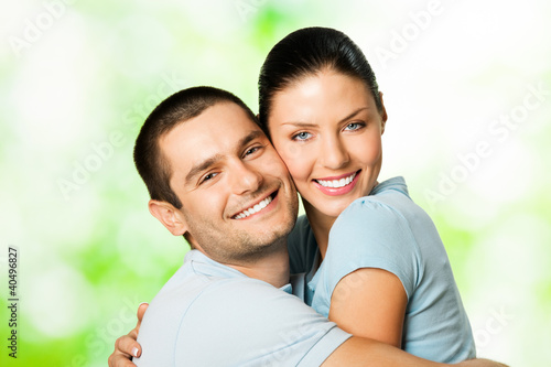 Portrait of young smiling couple, outdoors