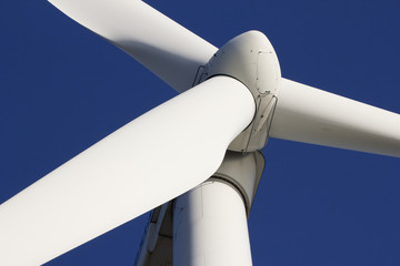 A wind-turbine against a clear blue sky