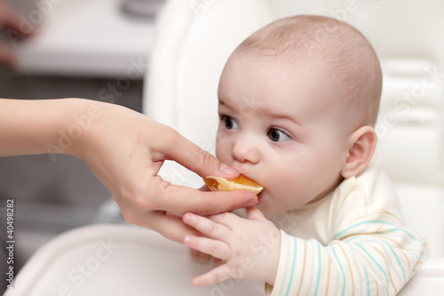 Baby eating cantle of orange