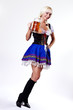 Young woman in folk costume holding a glass of beer