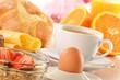 Breakfast with coffee, rolls, egg, orange juice, muesli and chee