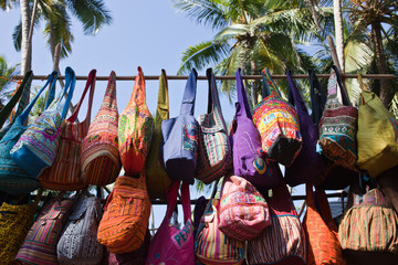 Colourful bags for sale at Anjuna market. India.