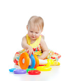 smiling little girl playing with color toy