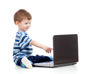 Funny child touching to  laptop over white background