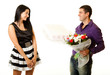 handsome young man handing over a flowers to a beautiful woman