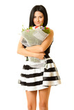 pretty woman holding flowers against white background