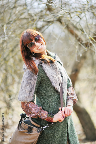 Fashionable smiling woman with sunglasses outdoors
