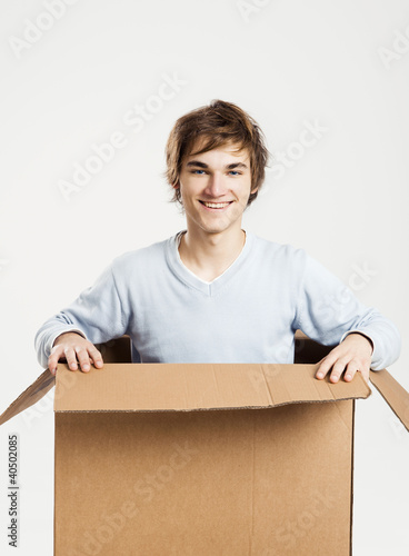 Man inside a card box