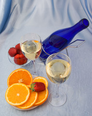 Glasses of wine with oranges and strawberry