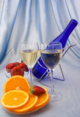 Two glasses of wine with oranges and strawberry