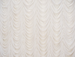 Beautiful beige curtain with the waves