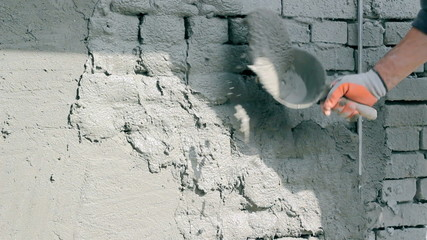 Applaying Plaster To A Brick Wall