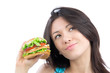 Young woman with tasty fast food unhealthy burger