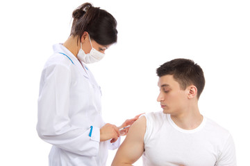 Doctor make flu vaccination or insulin injection shot