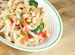 Thai Rice Noodle Salad in a bowl sitting on a table
