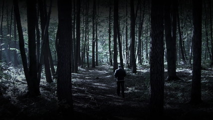 Man runs in dark woods, special effect