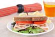 Healthy turkey sandwich on whole wheat bread.
