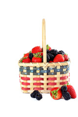 Patriotic basket of fresh strawberries and blackberries.