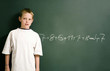 Boy standing in front of the mathematical solution