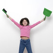 Girl holding a dustpan and a brush