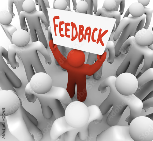 Feedback Man Holding Sign in Crowd Sharing Opinion