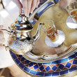 Pouring moroccan tea from teapot