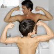 Father and son showing off their muscular arms