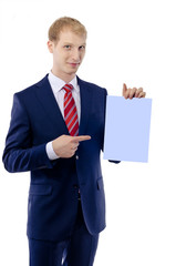 Happy smiling young business man showing blank signboard, isolat