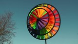 whirligig pinwheel with wind chimes poster