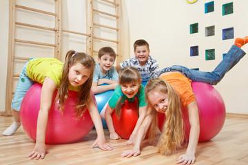 Kids on  gymnastic balls