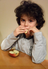 Curly child eating an apple 2