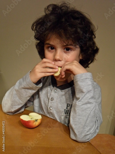 Curly child eating an apple 3