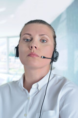 Blondy beautiful girl with headphone in call center