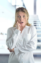 Surprised secretary is looking in the office