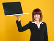attractive, young businesswoman holding a laptop