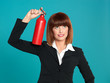 attractive businesswoman, using fire extinguisher on head