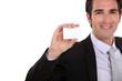 Confident businessman presenting card
