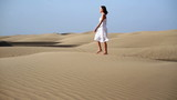 Young woman walking on the desert
