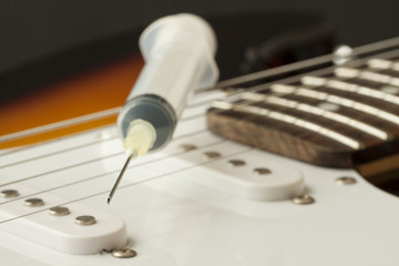 Syringe and guitar