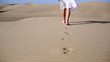 Woman feet walking on the desert