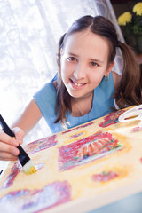 positive schoold girl are painting at home