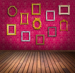 vintage frame in pink wallpaper room