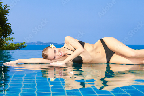 Smiling Woman Reflected In Pool